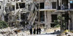 Suicide attacks on bases in Syria's Homs kill 42