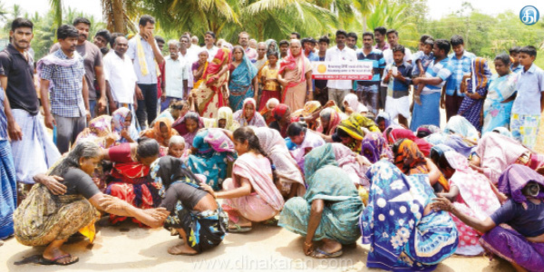 People struggle in front of the hydrocarbon project