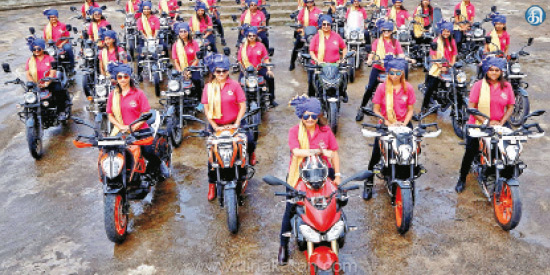 Women who go on a rally bike on the rights to women in Gujarat