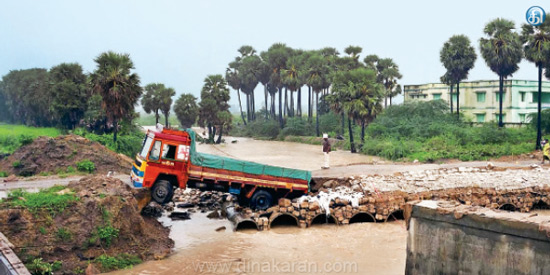 Cement lorry was trapped near the bridge near Thoothukudi