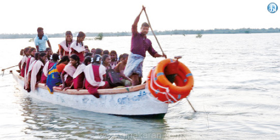 Students passing through the river in the boat near Vedaranyam