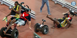 Usain Bolt Is Knocked Over By Segway-Riding Cameraman After Winning Gold