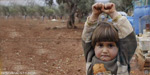 Syrian girl thought the photojournalist was holding a weapon, so she 'surrendered'