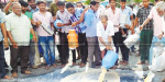 Purchase of aawin stations closure Farmers protest milk poured on the road
