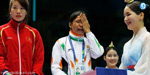 Sarita Devi referee to protest the refusal to wear the medal