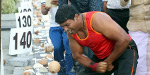 Strongman muscles his way to world record by smashing 124 coconuts with his bare hands in less than a minute
