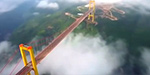 Spectacular aerial footage shows an enormous bridge built over a 1,600ft deep valley by Chinese engineers