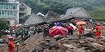 Terrifying moment a massive landslide triggered by Typhoon Megi devours a Chinese village as rescuers search for 33 swallowed by sea of mud