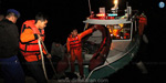 1 dead and dozens missing in Indonesia after a boat overturned in Lake Toba