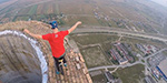 Daredevil scales 840ft chimney and performs tricks around its crumbling rim on a UNICYCLE