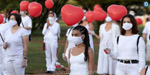 Balloons fired in honor of coroner's death in Brazil: photos