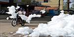 Flammable foam hits the streets of Bangalore after river has so much sewage pumped into it that it creates a toxic 'clouds' of bubbles
