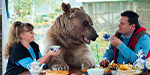 Un bear lievable! Russian family sit down to dinner with a 300lb BEAR at the table