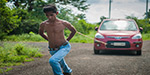 Indian teenager shows off his superhuman strength by pulling TWO CARS with his shoulders