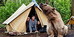 Russian family take their tame pet brown bear Stepan on holiday as they enjoy a camping trip in the countryside