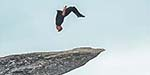 Daredevil performs a somersault on the edge of Norway's 700m high 'Troll's Tongue'