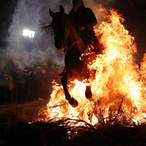 Animal sanctification festival: Spain people paying horses in the fire