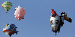 Balloons ascend into desert skies as the 44th annual International Balloon Fiesta launches in New Mexico