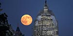 Blue Moon appears in sky - Moon shines unusual silvery grey colour
