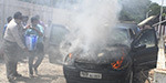 Car standing beside the railway gate suddenly caught fire yesterday