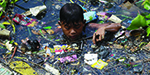 Horrific pictures of Filipino children sifting through rivers of rubbish in desperate bid to find something to sell