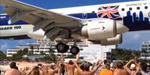 Tourist captures incredible footage of plane passing just overhead of people
