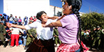 Bolivian men and women in violent harvest festival