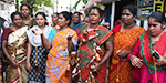 Women involved in liquor prohibition protest - they tied the alcoholic bottles with thaali