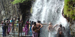 Veyililum light invasion of tourists to the waterfall pouring water Papanasam Agastya