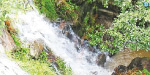 Water pouring into the falls in the Thimbam Mountains due to continuous rain