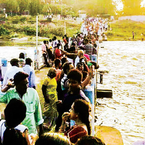 Passengers traveling on the Vaigai dam for the summer holiday