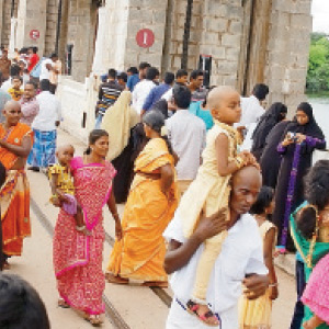 Tourists gathered at Sathanur Dam yesterday as the holiday day