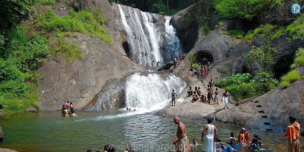 Ananda in the water bath for tourists to feel the scorching veyililum Agastya Falls